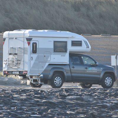 Rijden op strand met 4x4 camper